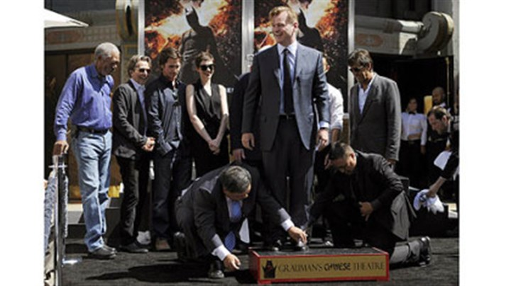 "Christopher Nolan Christopher Nolan, center, director of the film ""The Dark Knight Rises,"" is surrounded by cast members from the film as he takes part in his hand and footprint ceremony at Grauman's Chinese Theatre on Saturday."