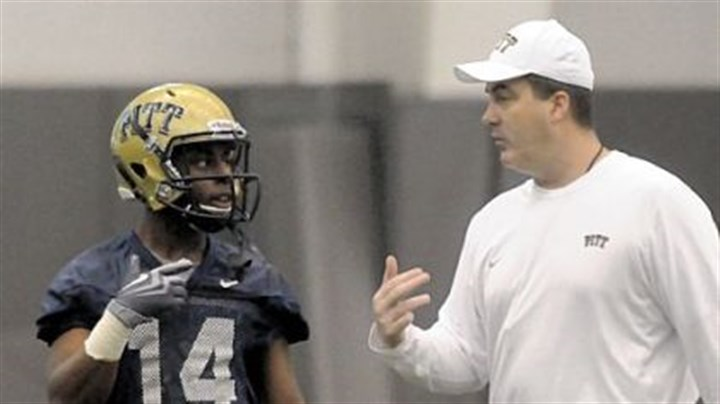 chryst New Pitt head football coach Paul Chryst works with wide receiver Ronald Jones.