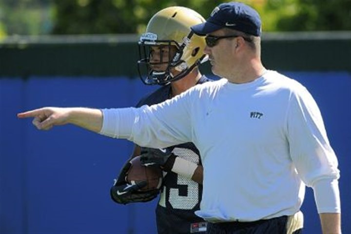 chryst Pitt coach Paul Chryst instructs wide receiver Tyler Boyd in practice Tuesday at the team's South Side facility.