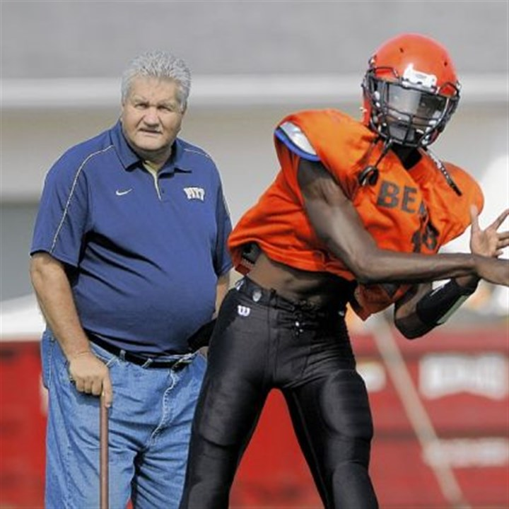 Clairton Bears Clairton quarterback Aaron Matthews throws under the watchful eye of coach Tom Nola.