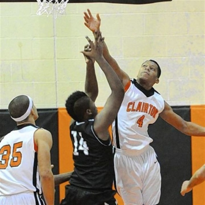 Clairton Bears Clairton's Jojuan Bray blocks a shot by Monessen's Nickodemes Payne during a Bears victory last Friday.