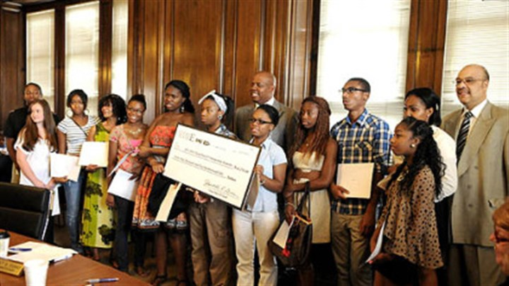 Clean Slate E3 scholarships Students pose with A. Fulton Meachem Jr., exective director of the Housing Authority, and Councilman Rev. Ricky Burgess after the authority's nonprofit affiliate, Clean Slate E3, awarded 20 scholarships today.