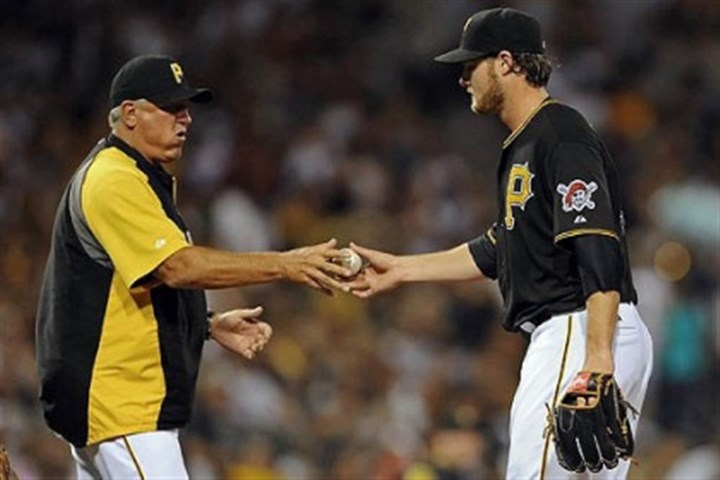 Clint Hurdle and Gerrit Cole Pirates manager Clint Hurdle takes starter Gerrit Cole out of the game against the Rockies in the sixth inning at PNC Park Friday night.