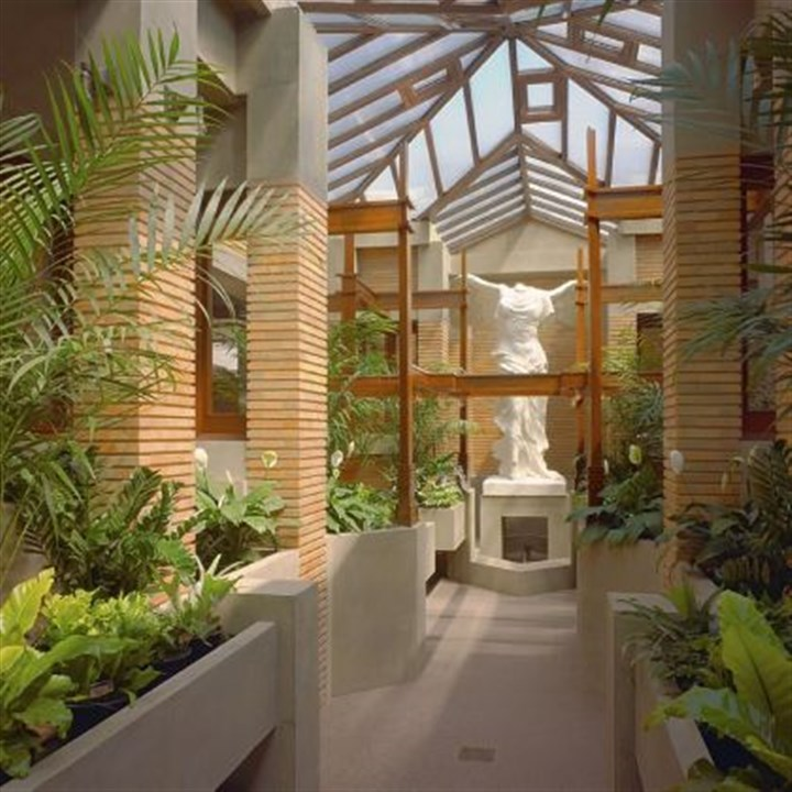 "Conservatory A 9-foot-tall classical statue, ""Nike of Samothrace,"" in the reconstructed conservatory is the focal point of the Darwin Martin House in Buffalo, N.Y."