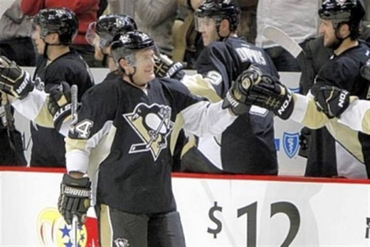 cooke Matt Cooke celebrates his second-period goal against the Capitals Thursday at Consol Energy Center.