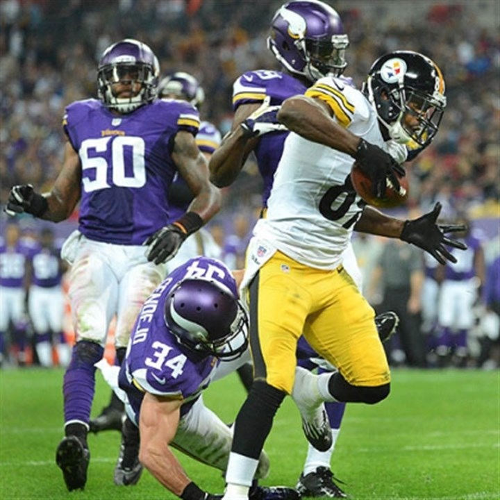 cotchery catches pass Steelers Jerricho Cotchery catches touchdown pass from Roethlisberger in the fourth quarter against the Vikings