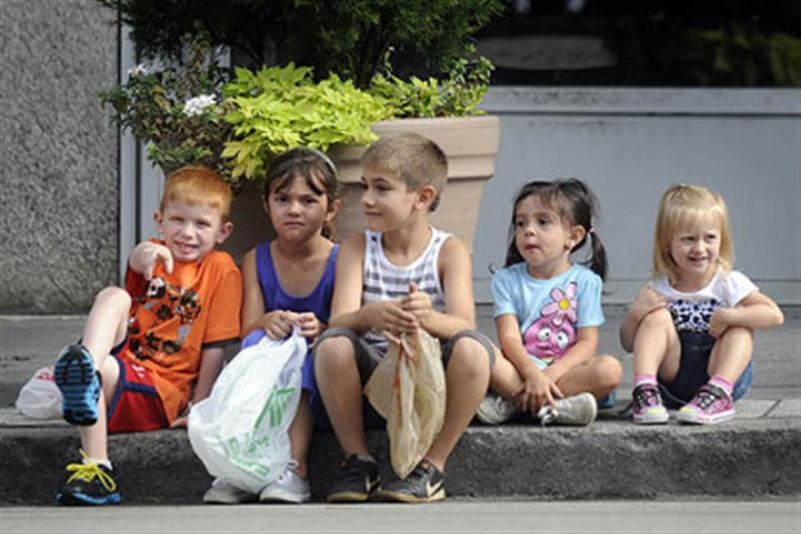 Cousins Cousins (from left) Toby Caylor, 6, Averie Capozzoli, 6, Antonio Schirripa, 8, Ally Capozzoli, 3, and Ayda Snyder, 2, watch the Labor Day Parade Monday Downtown.