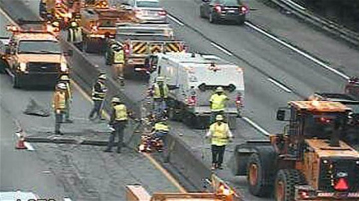 Crash scene A PennDOT camera shows crews just after sunrise working to clear the crash scene on the Parkway West.