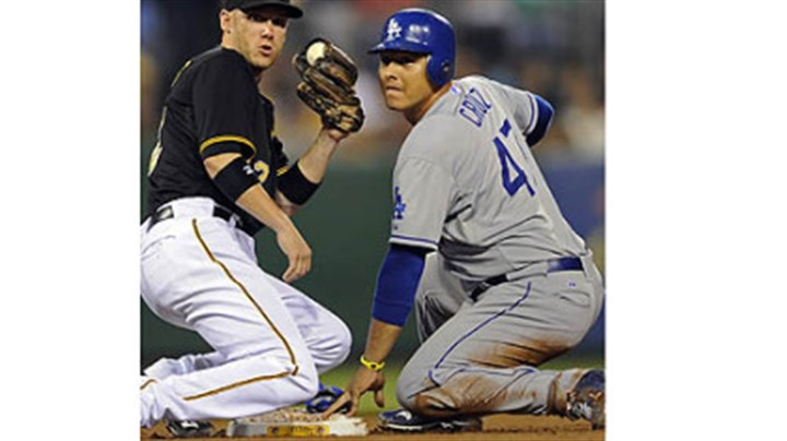 cruz Dodgers' Luis Cruz gets into second base safely on a steal against Pirates' Clint Barmes in the third inning Tuesday night at PNC Park.