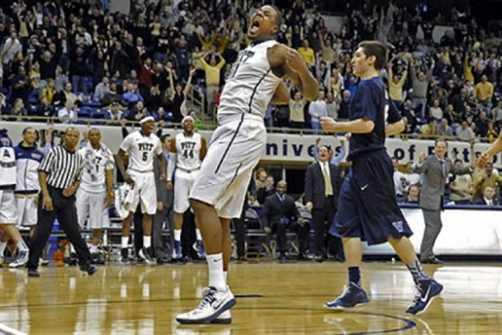 DanteTaylor Pitt's Dante Taylor celebrates after dunking in the final seconds against Villanova in overtime Sunday at the Petersen Events Center.