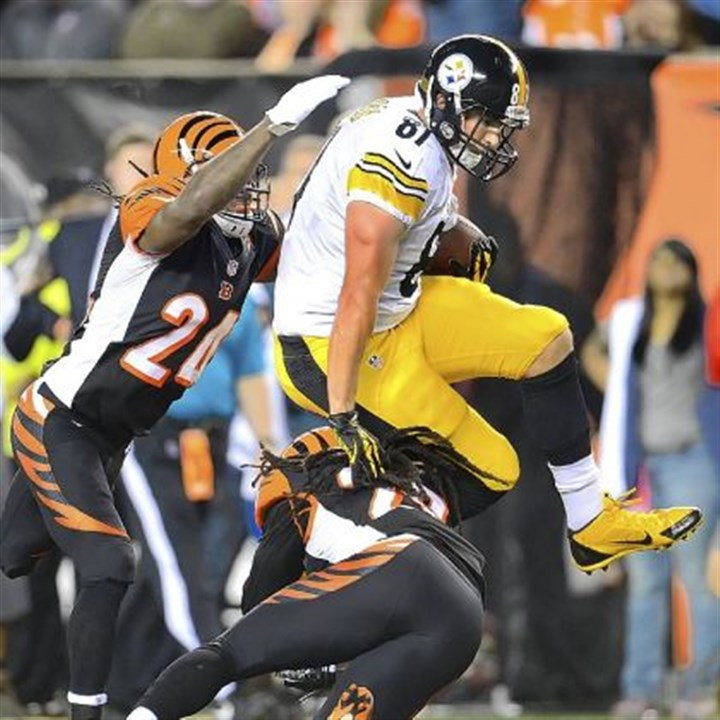 David Paulson Steelers tight end David Paulson makes a leap before fumbling the ball trying to avoid two Bengals Monday night.