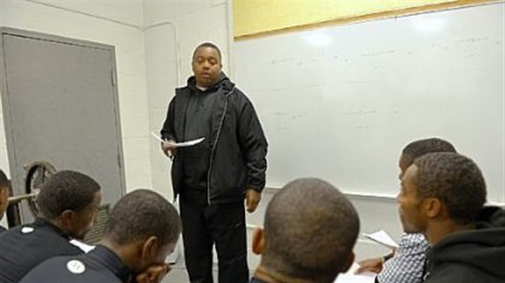 Defensive coach Wayne Wade Defensive coach Wayne Wade, 40, goes over strategy with the Bears in the team's weight room in November. Wade, who is from Clairton, was the team's quarterback in 1989 when the Bears won the WPIAL Class A championship.