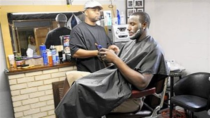 DeJuan Blair DeJuan Blair keeps up with his text messages as he gets a haircut by his friend Greg Mitchell in Monroeville yesterday. Blair slipped to the second round of the NBA draft and was chosen by the San Antonio Spurs.
