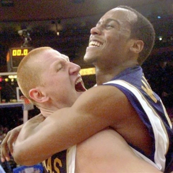 DonatasBrandin Donatas Zavackas and Brandin Knight celebrate Pitt's Big East tournament championship in 2003. The Panthers beat Connecticut in the final after losing the two previous championship games at Madison Square Garden.