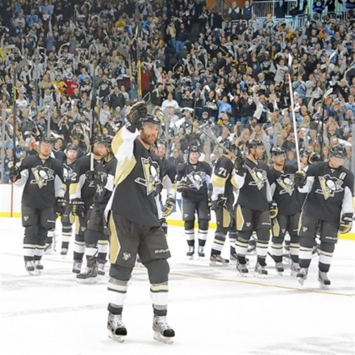 dupuis Penguins salute the fans at Consol Energy Center while being led by left winger Pascal Dupuis after beating the Ottawa Senators in Game 5 on Friday night.