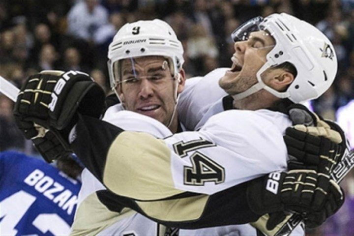 dupuis Pascal Dupuis, left, celebrates with Chris Kunitz after scoring in the third period Thursday against the Maple Leafs in Toronto. The Penguins won, 3-1.