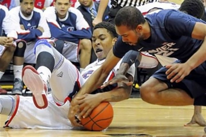 Duquesne Duquesne's Derrick Martin and Xavier's Jeff Robinson go for a loose ball in the first half Saturday night at Consol Energy Center.
