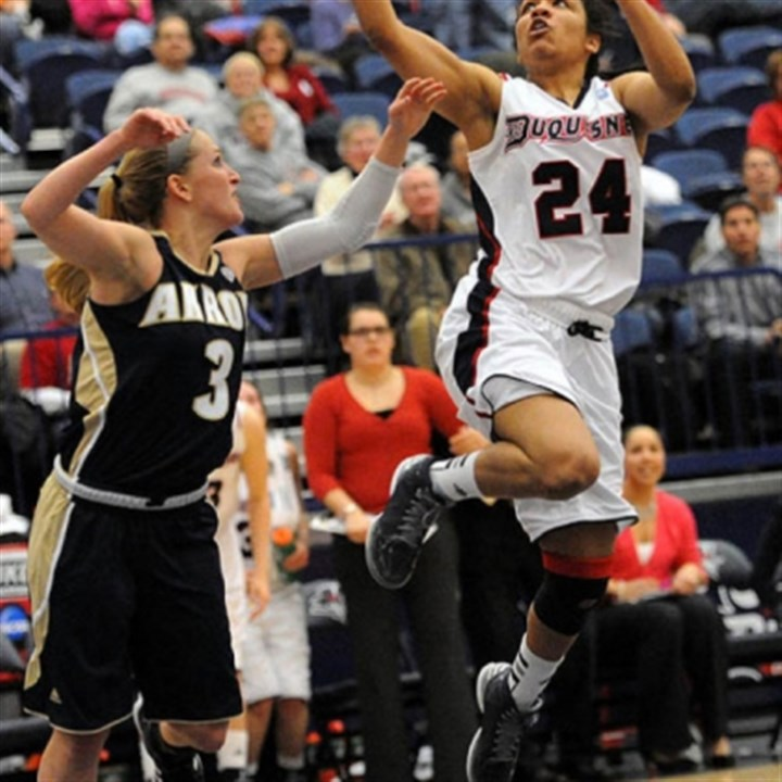 Duquesne 1 Duquesne's Vanessa Abel, right, scores over Akron's Kacie Cassell in the first round of the Women's NIT Thursday at Palumbo Center. Abel scored 13 of the Dukes' final 15 points to secure the victory, 71-66.