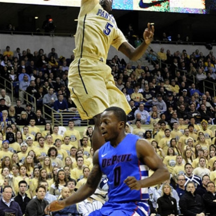 Durand Johnson and Worrel Clahar Pitt's Durand Johnson dunks in front of DePaul's Worrel Clahar in the first half.