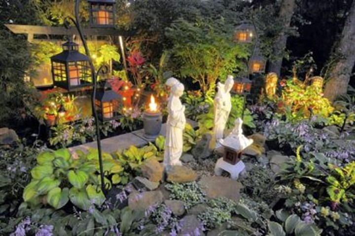 Ed McHugh's garden Lighting transforms the backyard of Ed McHugh's garden in Reserve into a magical place at night.