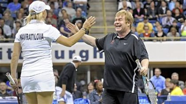 Elton John and Martina Navratilova Tennis great Martina Navratilova and Sir Elton John celebrate a win during the Mylan WTT Smash Hits World Team Tennis Match at the Petersen Events Center Tuesday night. The event raised $1 million for the first time in its 20-year history.