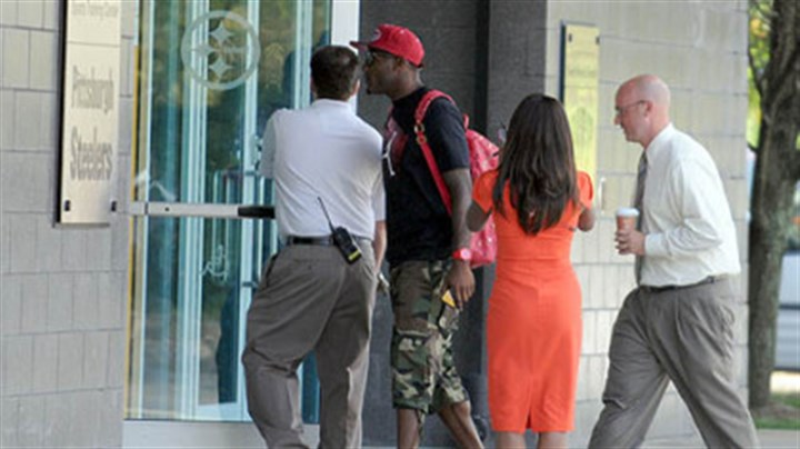 Entering South Side facility Wide receiver Mike Wallace enters the Steelers' South Side facility on Tuesday.