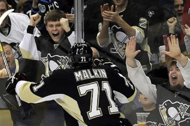 Evgeni Malkin celebrates Penguins fans and Evgeni Malkin celebrate his third-period goal against the Lightning in a March 5 game at Consol Energy Center.