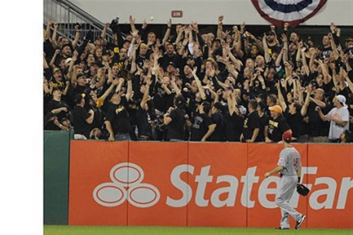 Fans Fans catch a home run ball in the second inning hit by Pirates outfielder Marlon Byrd.