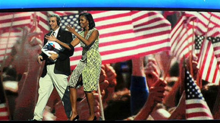First lady First lady Michelle Obama gets a feel for the stage inside of the Time Warner Cable Arena on Monday before the official start of the Democratic National Convention in Charlotte, N.C.