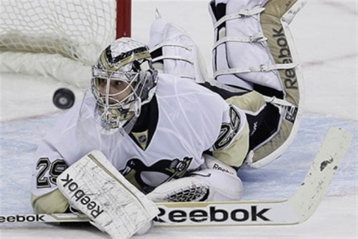 Fleury Marc-Andre Fleury makes one of his 25 saves against the Jets Friday in Winnipeg, Manitoba.