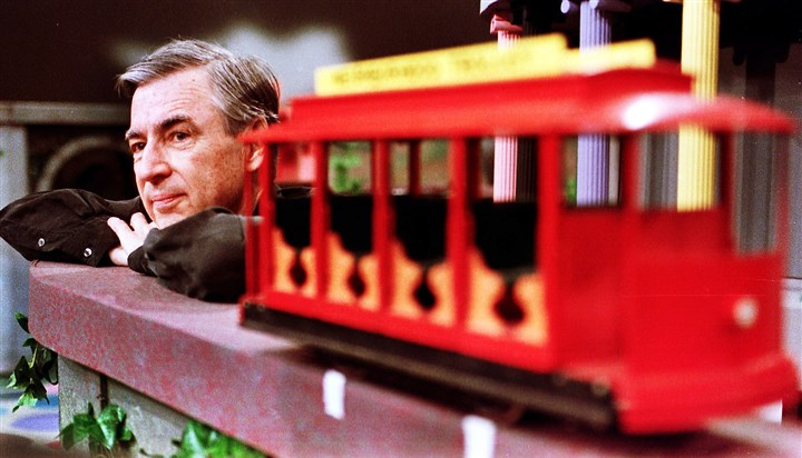 "Fred Rogers file Fred Rogers pauses during a taping of his show ""Mister Rogers' Neighborhood."""