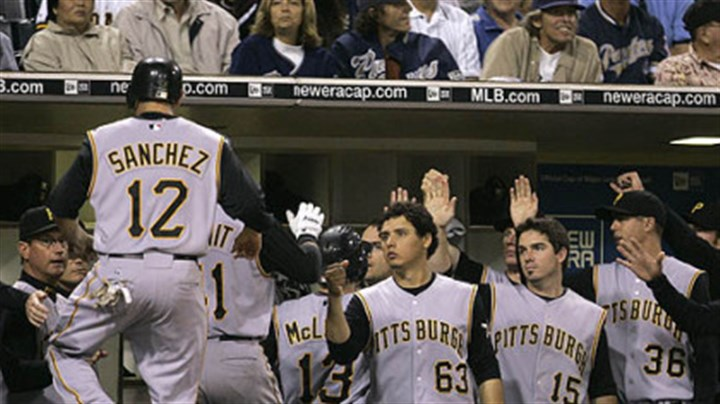 Freddy Sanchez The Pirates' Freddy Sanchez (12) is greeted at the dugout after Doumits' three-run home run against the San Diego Padres in the sixth inning of last night's game Friday in San Diego.