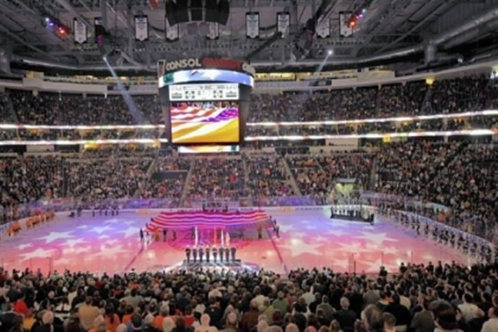 frozenfour Fans stand for the National Anthem before the start of the national championship Saturday at Consol Energy Center.