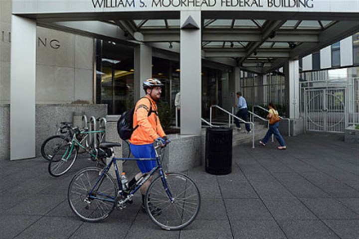 furlough local Joseph Bossard, an employee of the Army Corps of Engineers, leaves the William S. Morehead Federal Building at lunchtime after being furloughed.