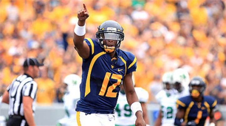 Geno Smith West Virginia University quarterback Geno Smith celebrates a touchdown pass against Marshall during today's game in Morgantown.