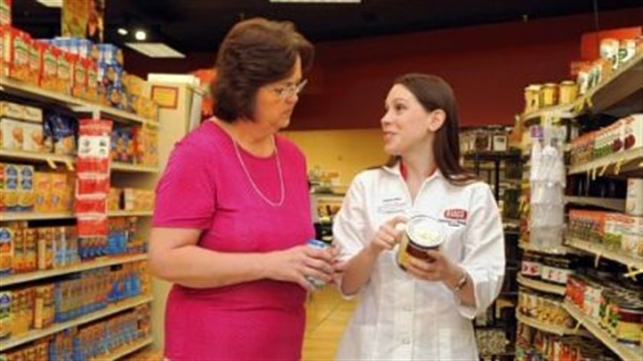 Giant Eagle Lori Mitchell of Cecil talks with Samantha Masters, a registered dietitian and wellness coach for Giant Eagle, at the McMurray Giant Eagle.