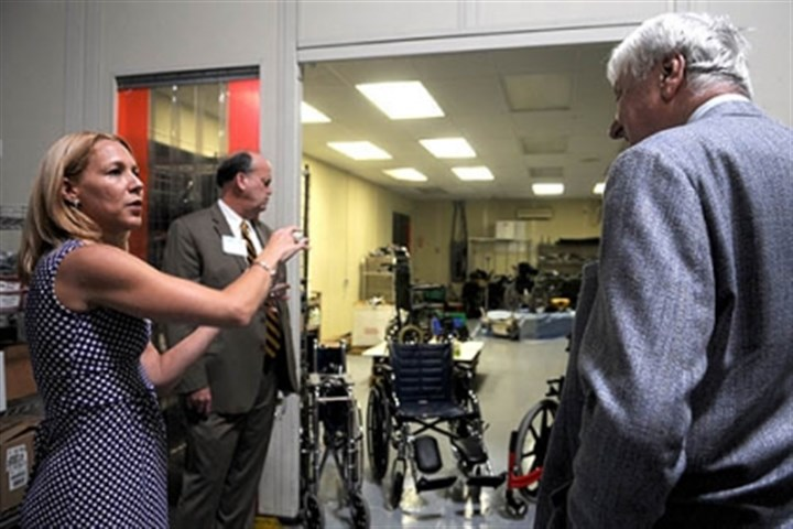 global links Hayley Brugos, medical outreach manager for Global Links, shows off a new wheelchair repair room on a tour of the new facility in Green Tree.