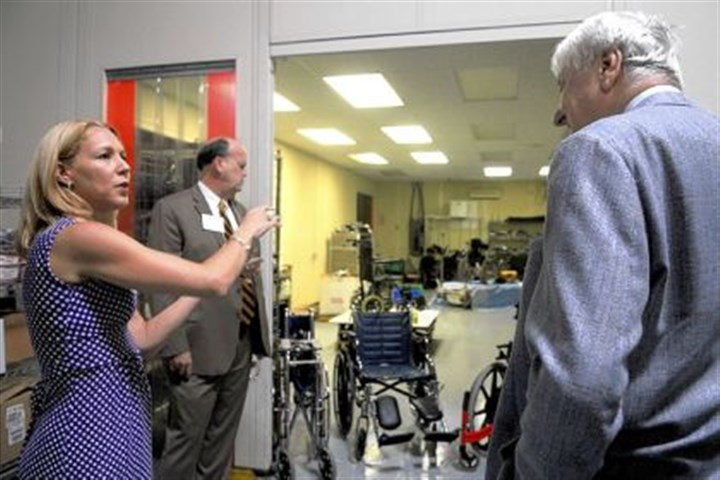Global Links Hayley Brugos, medical outreach manager for Global Links, shows off a new wheelchair repair room on a tour of the nonprofit's new facility in Green Tree on Friday.