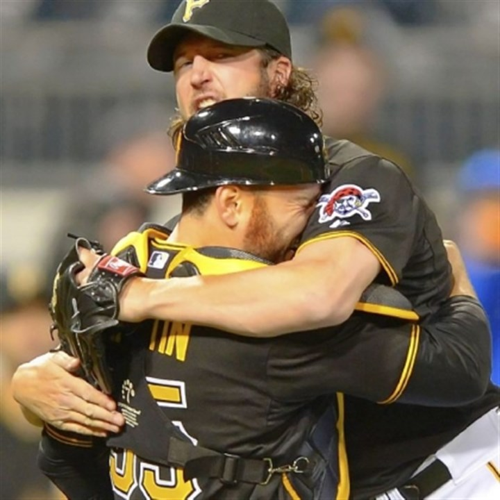 grilli Pirates closer Jason Grilli, right, celebrates with catcher Russell Martin after finishing the ninth inning to beat the Reds, 6-5, Friday night at PNC Park.