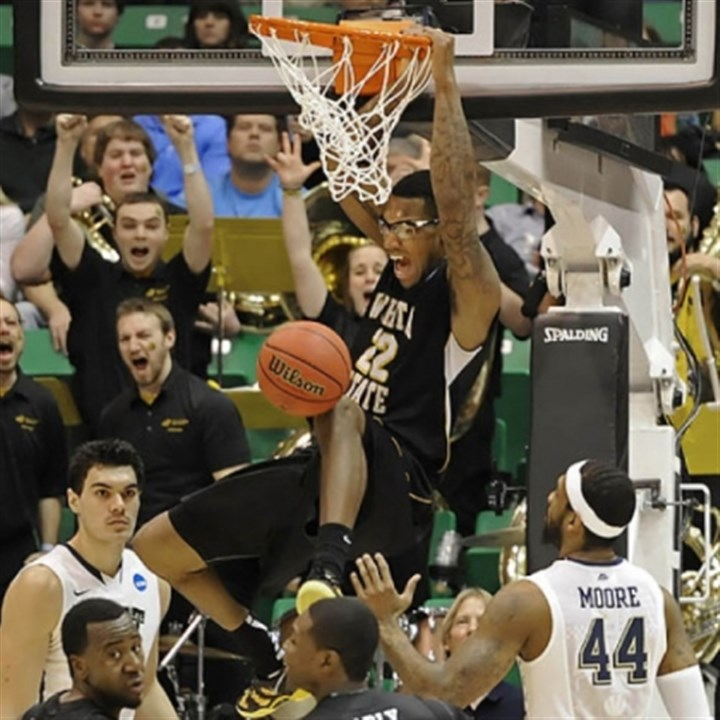 Hall Wichita State's Carl Hall dunks against Pitt in the second half of the second round of the NCAA tournament at EnergySolutions Arena. Wichita State knocked Pitt out of the tournament with a 73-55 victory.