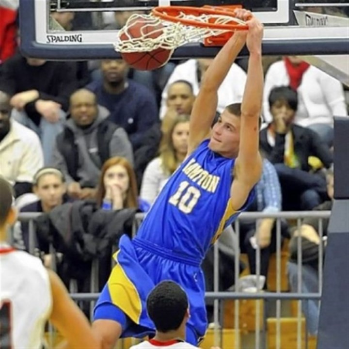 Hampton Hampton's Ryan Luther dunks against New Castle in the WPIAL Class AAAA championship last Saturday.
