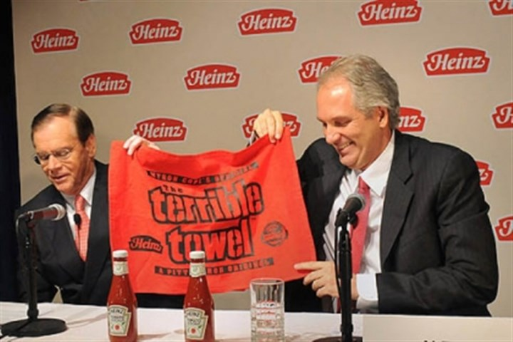 heinz terrible towel At a press conference Thursday, Alex Behring, right, managing partner at 3G Capital was presented with a Heinz red Terrible Towel by William R. Johnson, chairman, president and CEO of Heinz.