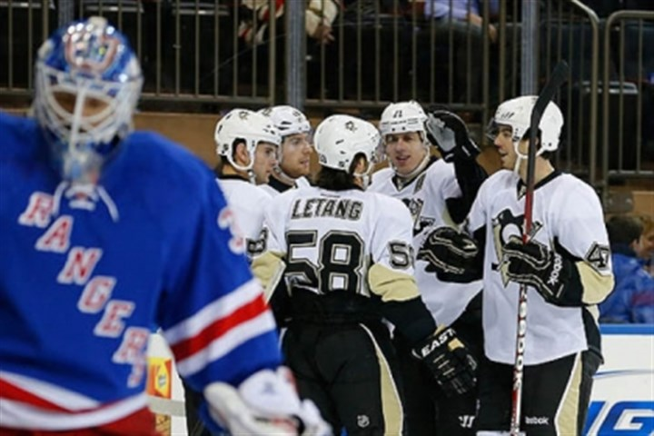 Henrik Lundqvist Rangers goalie Henrik Lundqvist skates away as the Penguins' Evgeni Malkin celebrates scoring a goal with teammates in the first perod.