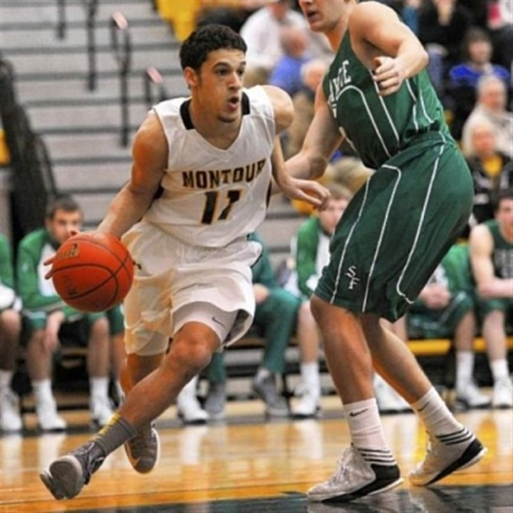 High school Montour Devin Wilson drives around South Fayette's Justin Watson in a PIAA Class AAA first-round game Friday night at North Allegheny.