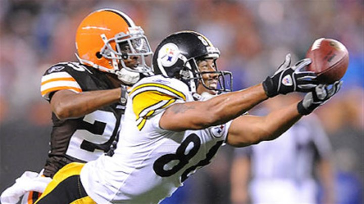 Hines Hines Ward stretches out for a pass from Ben Roethlisberger past the Browns' Terry Cousin.