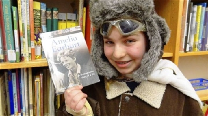 History-1 South Allegheny Elementary fifth-grader Julia Nelson portrays Amelia Earhart for classmates as she discussed the aviator's life.