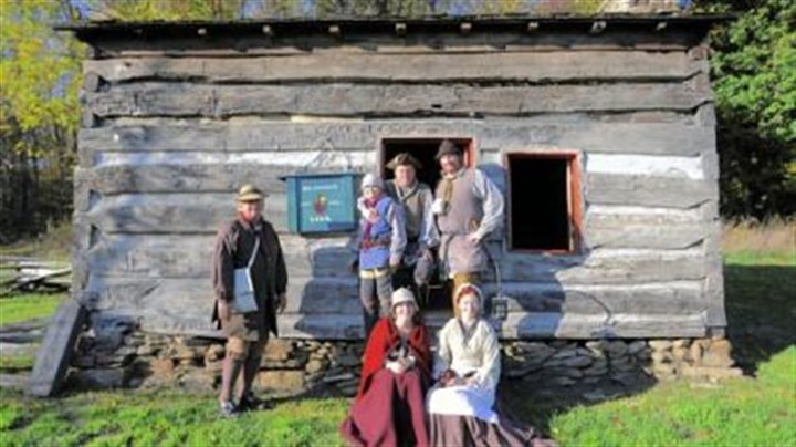 History 1 Re-enactors portraying people who lived during the Revolutionary War period are, seated in front, Jessica Baker, left, and Kate Cunning. Standing behind them are, from left, John Cunning, Nathan Baker, Rich Baker and Bryan Cunning. The group is outside of the Bloody Dirt Tavern at the Enoch Wright House in Peters. Bryan Cunning is known for his portrayal of George Washington.
