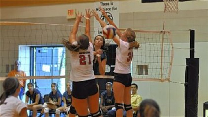 Hopewell Volleyball Hopewell's Mackenzie Biggs spikes a shot between Moon's Morgan Malcolm (21) and Katy Peters.