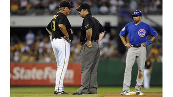 Hurdle argues with second base umpire Pirates manager Clint Hurdle argues with second base umpire Rob Drake after Cubs' David DeJesus was called safe at second base on a tag by Pirates' Neil Walker in the seventh inning.