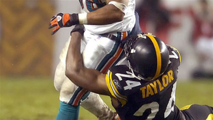 Ike Taylor Taylor takes down Dolphins' running back Patrick Cobbs in the third quarter. (vs. Dolphins 11/26/07)